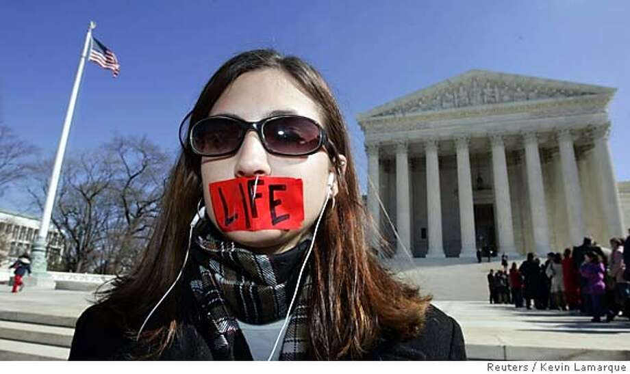 A pro-life demonstrator protests outside the U.S. Supreme Court in Washington February 21, 2006. The U.S. Supreme Court said on Tuesday it will decide whether a ban on some abortion procedures is unconstitutional, a case that could show if the reshaped court will restrict a woman's right to an abortion. REUTERS/Kevin Lamarque 0 Photo: KEVIN LAMARQUE