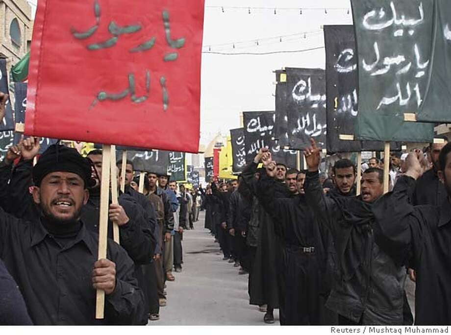 Iraqis carry placards professing their faith to the Prophet Mohammad during a protest in Kerbala, 110 km (70 miles) south of Baghdad February 21, 2006, against the cartoons and caricatures depicting the Prophet Mohammad published in several European newspapers. REUTERS/Mushtaq MuhammadRan on: 02-22-2006  Carrying placards proclaiming their faith, Iraqis march in the city of Karbala to protest cartoons mocking the Prophet Muhammad. Photo: MUSHTAQ MUHAMMAD