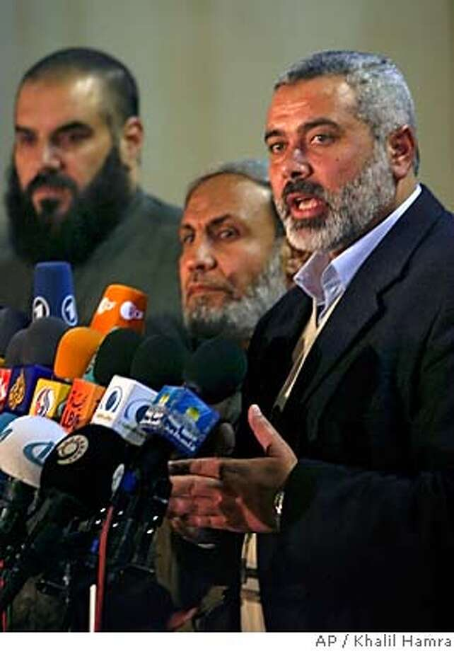 From right to left: Hamas leaders Nizar Rayan, Mahmoud Zahar, Ismail Haniyeh, Hamas's choice for Palestinian prime minister at a news conference after talks with Palestinian Authority President Mahmoud Abbas, also known as Abu Mazen, in Gaza City, Monday, Feb. 20, 2006. Palestinian President Mahmoud Abbas began a meeting Monday with Ismail Haniyeh, and he is expected to name the Hamas official as the next Palestinian prime minister. Haniyeh, whose group won an overwhelming majority in Jan.25 parliamentary elections, will have five weeks to form a Cabinet. (AP Photo/Khalil Hamra) Photo: KHALIL HAMRA
