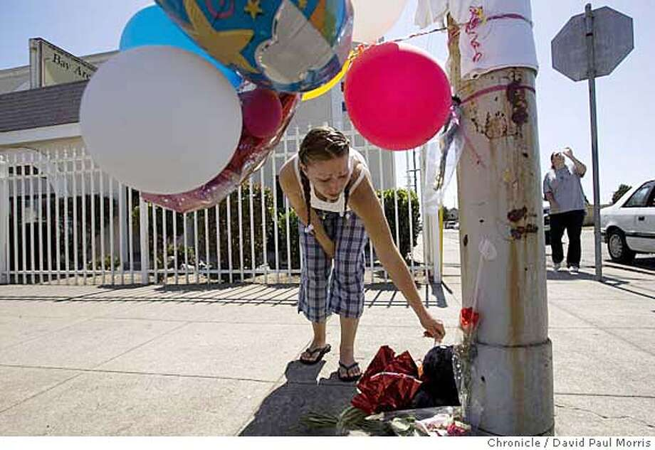 RICHMOND, CA - SEPTEMBER 13: Michelle Hayhurst , 23 cries at a memorial for Jewell Mayweather Jr., who was shot and killed on the corner of Second Street and Macdonald Avenue September 13, 2007 in Richmond, California. (Photo by David Paul Morris/The Chronicle) Photo: David Paul Morris