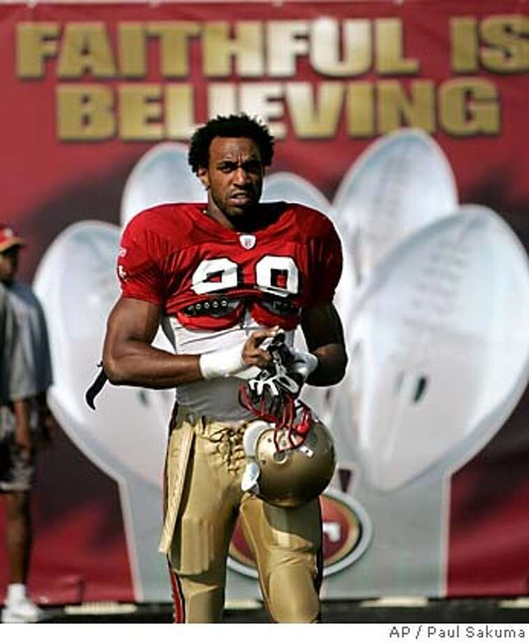 San Francisco 49ers linebacker Julian Peterson walks to practice at the 49ers practice facility in Santa Clara, Calif., Thursday, Aug. 4, 2005. (AP Photo/Paul Sakuma) Ran on: 08-05-2005  Julian Peterson is almost 100 percent after tearing his Achilles less than a year ago. Ran on: 08-05-2005  Julian Peterson is almost 100 percent after tearing his Achilles less than a year ago. Photo: PAUL SAKUMA