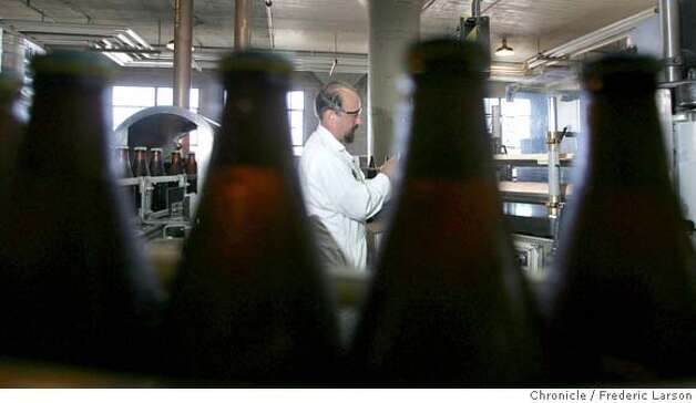 Rick Hendricks works the bottle line at the century-old Anchor Brewing Co., one of the city's renowned small manufacturers. Photo: Frederic Larson