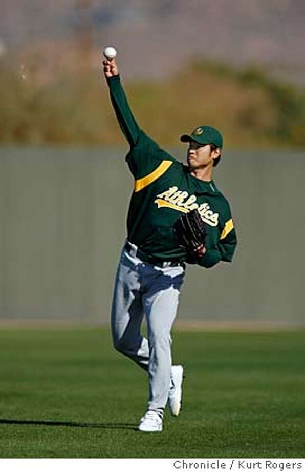 Mac Suzuki warms upn as throws about 30 balls.  The Oakland Athletics work out at Papago Park in Phoenix AZ  Kurt Rogers PHOENIX SFC  The Chronicle ATHLETICS_00206_kr.JPG MANDATORY CREDIT FOR PHOTOG AND SF CHRONICLE/ -MAGS OUT Photo: Kurt Rogers