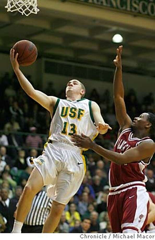 usfbasketball_201_mac.jpg USF's 13- Drew Shiller had 23 points in therir loss to Santa Clara, covered by 24-Calvin Johnson, second half action. College Basketball USF vs. Santa Clara. Event in San Francisco, Ca on 2/21/06 Photo by : Michael Macor/ San Francisco Chronicle  Ran on: 02-21-2006  USF freshman guard Drew Shiller scored a career-high 23 points, but it wasn't enough against Santa Clara. Photo: Michael Macor