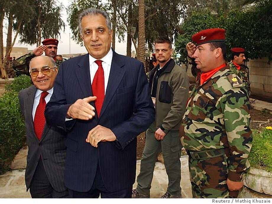 Iraqi army officers salute the U.S. ambassador to Iraq Zalmay Khalilzad (C) as he arrives to a meeting with Iraqi political leaders in Baghdad February 2, 2006. REUTERS/Wathiq Khuzaie/PoolRan on: 02-21-2006  Zalmay Khalilzad, U.S. ambas- sador to Iraq, said U.S. aid could be cut if sectarians take charge. Photo: Pool