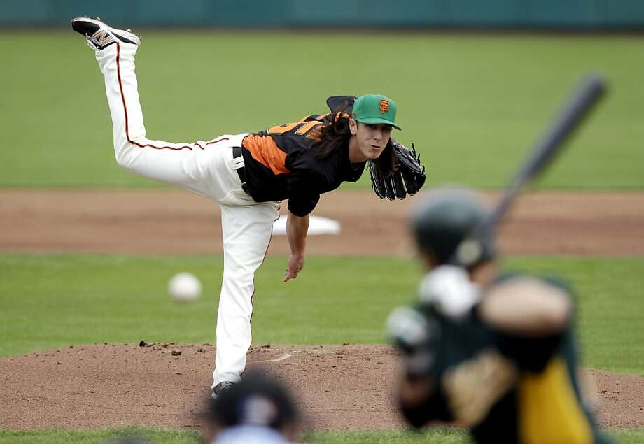 San Francisco Giants starting pitcher Tim Lincecum throws against the Oakland Athletics during the first inning of a spring training baseball game Saturday, March 17, 2012 in Scottsdale, Ariz. (AP Photo/Marcio Jose Sanchez) Photo: Marcio Jose Sanchez, Associated Press