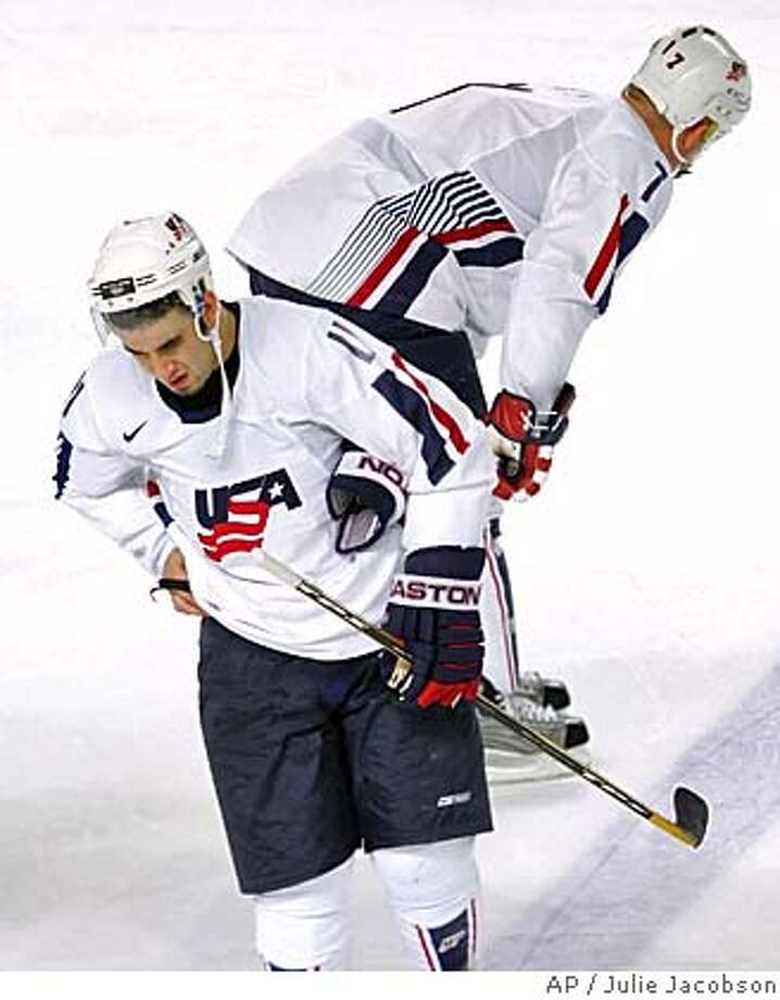 United States hockey players Scott Gomez, foreground, and Keith Tkachuk react after their 2-1 loss to Sweden in an ice hockey match at the 2006 Turin Winter Olympics in Turin, Italy Sunday Feb. 19, 2006. (AP Photo/Julie Jacobson) Photo: JULIE JACOSON