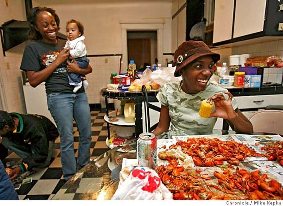shatondaNewOrleans111_mk.JPG  Surrounded by family now at her mothers house in New Orleans, Shatonda said the food was one of the things she missed most about New Orleans as she works on a 10-pound-pile of crawfish. - Shatonda is staying at her mother's house until FEMA comes through with a trailer. It has been 6 weeks since Shatonda Yarbrough and her daughter Miochie Martin, 4, moved back to New Orleans. In September they were displaced in Oakland, CA after Hurricane Katrina destroyed their house in the East 9th Ward. Mike Kepka / The San Francisco Chronicle MANDATORY CREDIT FOR PHOTOG AND SF CHRONICLE/ -MAGS OUT Photo: Mike Kepka