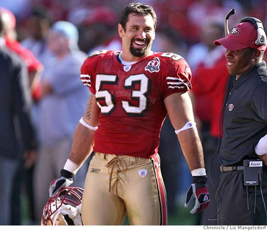 San Francisco 49ers linebacker Jeff Ulbrich (53) is all smiles on the sidelines near the end of the game. Oakland Raiders play the San Francisco Niners at Monster Park in San Francisco on Oct. 8, 2006. Liz Mangelsdorf /The Chronicle MANDATORY CREDIT FOR PHOTOG AND SF CHRONICLE/NO SALES-MAGS OUT Photo: Liz Mangelsdorf
