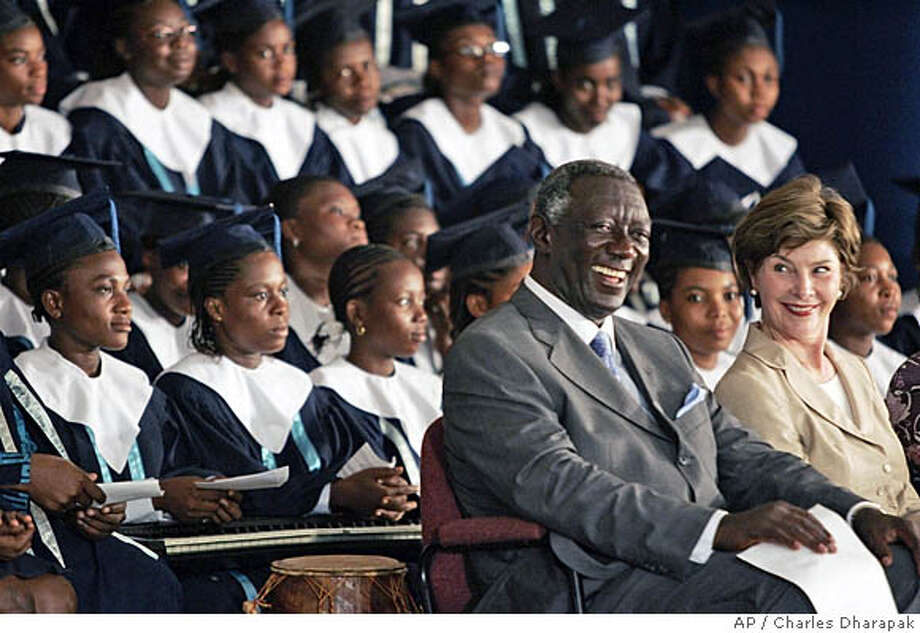 U.S. first lady Laura Bush, right, sits with Ghana's President John Agyekum Kufuor at the Accra Teacher Training Center where she launched the Africa Education Initiative Textbooks Program in Accra, Ghana, Tuesday, Jan. 17, 2006. (AP Photo/Charles Dharapak) Ran on: 01-18-2006  Photo caption Photo: CHARLES DHARAPAK