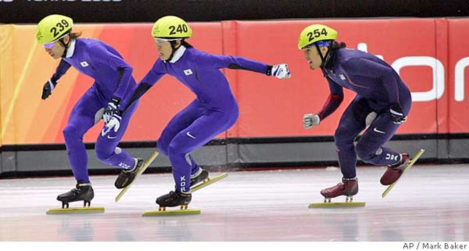 Ahn Hyun-soo, of South Korea, left, Lee Ho-suk, of South Korea, (240) and Apolo Anton Ohno, of the United States, rear, race to the finish of the men's 1000 meter final at Short Track Speedskating at the Turin 2006 Winter Olympic Games in Turin, Italy on Saturday, Feb. 18, 2006. Ohno could not get past the South Koreans and finished third with the bronze medal. Ahn won gold and Lee silver. (AP Photo/Mark Baker) Photo: MARK BAKER