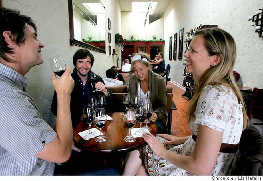 """BARBITES14_102_LH_.JPG Clockwise from left--Chip Dalby, Mick Petts, Tessa Swigart, and Echo Gaffney, all from San Francisco, having a """"Big BBQ Wines"""" flight at Que Syrah. Que Syrah is a neighborhood storefront wine bar in West Portal that features an ecletic list of wines and a vibrant bar scene.  Liz Hafalia/The Chronicle/San Francisco/8/18/07  **Echo Gaffney, Chip Dalby, Mick Petts, Tessa Swigart cq �2007, San Francisco Chronicle/ Liz Hafalia  MANDATORY CREDIT FOR PHOTOG AND SAN FRANCISCO CHRONICLE. NO SALES- MAGS OUT. Photo: Liz Hafalia"""