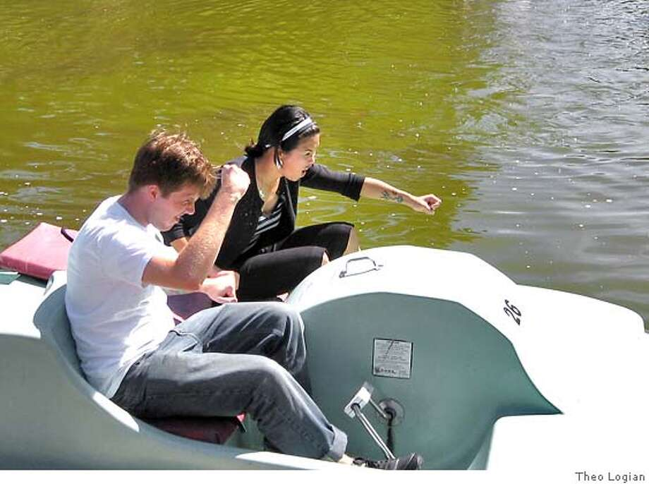Jackie Keh and Kris Range testing out the boats for the upcoming Paddle Boat races Photo: Theo Logian