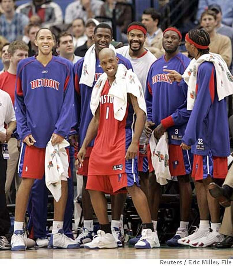 Detroit Pistons starters (L to R) Tayshaun Prince, Antonio McDyess, Chauncey Billups, Rasheed Wallace, Ben Wallace and Richard Hamilton cheer after teammate rookie Amir Johnson dunks the ball against the Minnesota Timberwolves near the end of their NBA game in Minneapolis January 24, 2006. Detroit won 107-83. REUTERS/Eric Miller Ran on: 01-29-2006  Detroit starters (from left) Tayshaun Prince, Antonio McDyess, Chauncey Billups, Rasheed Wallace, Ben Wallace and Richard Hamilton cheer a rout. Photo: ERIC MILLER