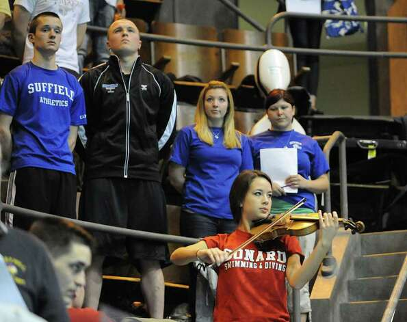Tiana Piscitelli, a Conard High School junior play the National Anthem on her violin at the start of the boys CIAC State Open Swimming championships at Yale University in New Haven, Conn., Saturday, March 17, 2012. Photo: Bob Luckey / Greenwich Time