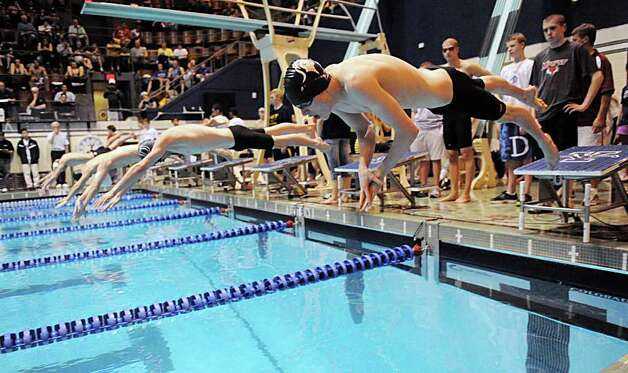 Jeff Anderson, at right, of Westhill/Stamford Co-op during the 200 IM at the Boys CIAC State Open Swimming championships at Yale University in New Haven, Conn., Saturday, March 17, 2012. Photo: Bob Luckey / Greenwich Time