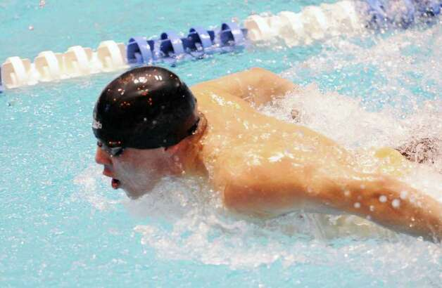 Armando Paolino of Pomperaug durng the 100 butterfly at the Boys CIAC State Open Swimming championships at Yale University in New Haven, Conn., Saturday, March 17, 2012. Photo: Bob Luckey / Greenwich Time
