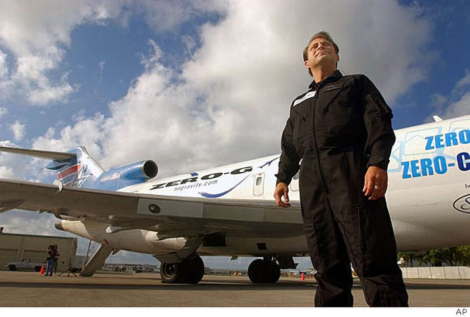 Peter Diamandis shows off his modified Boeing 727-200 Zero-G plane in Fort Lauderdale, Fla.  Associated Press photo by  J. Pat Carter
