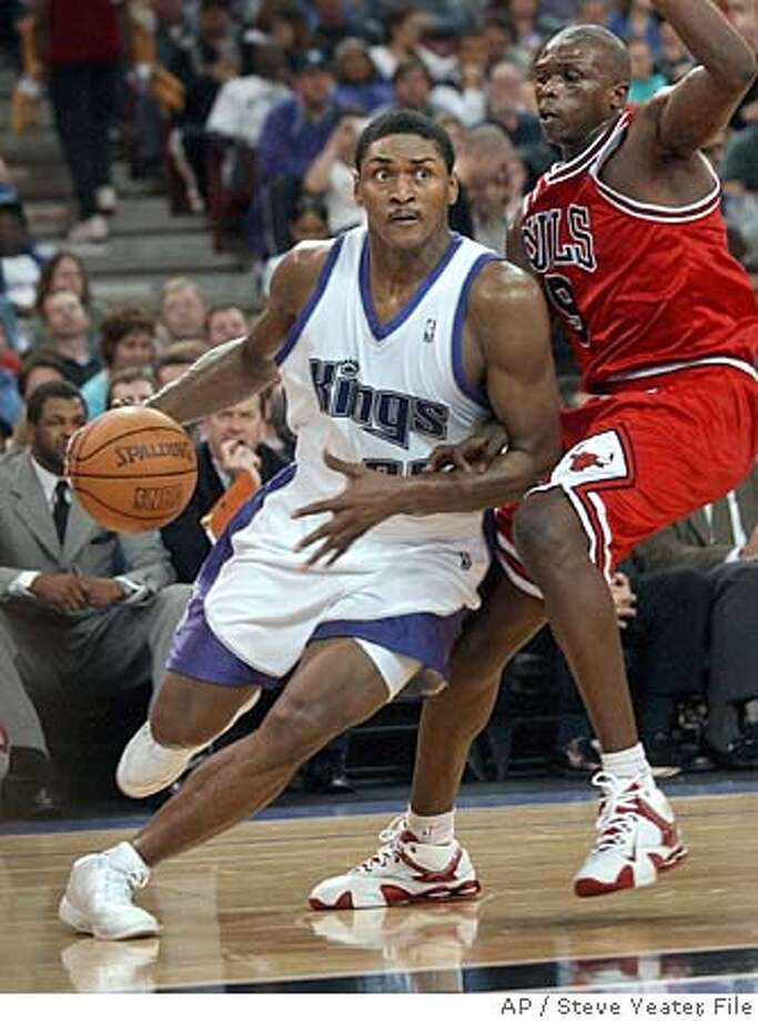 Sacramento Kings forward Ron Artest, left, drives around Chicago Bulls defender Luol Deng, of Sudan, during the second half of an NBA basketball game in Sacramento, Calif., on Thursday, Feb. 9, 2006. The Kings won 98-80. (AP Photo/Steve Yeater) EFE OUT EFE OUT Photo: STEVE YEATER