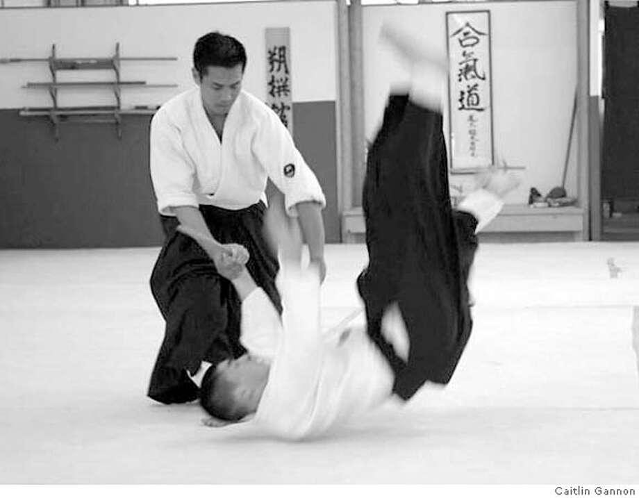Alameda Aikikai Chief Instructor Elmer Tancinco, fourth-degree black belt, Shidoin, demonstrates a basic throw move. Tancino, a graduate of the Kenshusei training program for dedicated practitioners of akido, is part of the Family Explorations! Martial Arts Around the World program at the Oakland Museum of California, Sunday, September 16, 14 p.m. Photo: Caitlin Gannon
