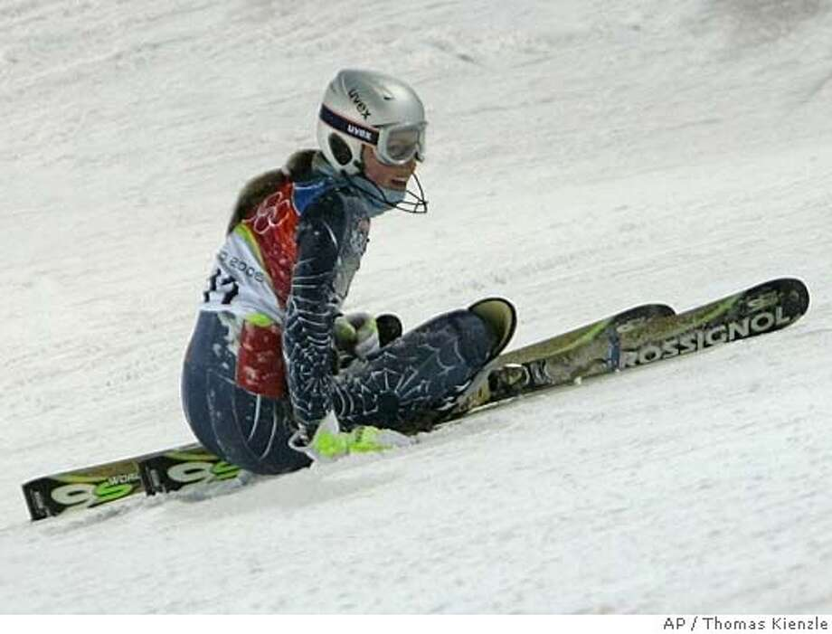 Lindsey C. Kildow of the United States sits on the course after falling during the 2nd run of the Women's Combined Slalom at the Turin 2006 Winter Olympic Games in Sestriere Colle, Italy Friday Feb. 17, 2006. (AP Photo/Thomas Kienzle) Photo: THOMAS KIENZLE