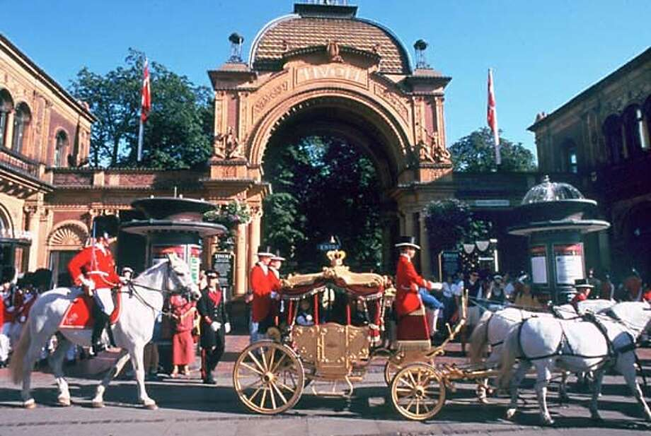 TRAVEL COPENHAGEN Nov. 9, 1999 � One of the sights for the tourist in Tivoli Gardens are the horsemen and buggies.(SHNS photo courtesy The Danish Tourist Board) Photo: Courtesy Danish Tourist Board