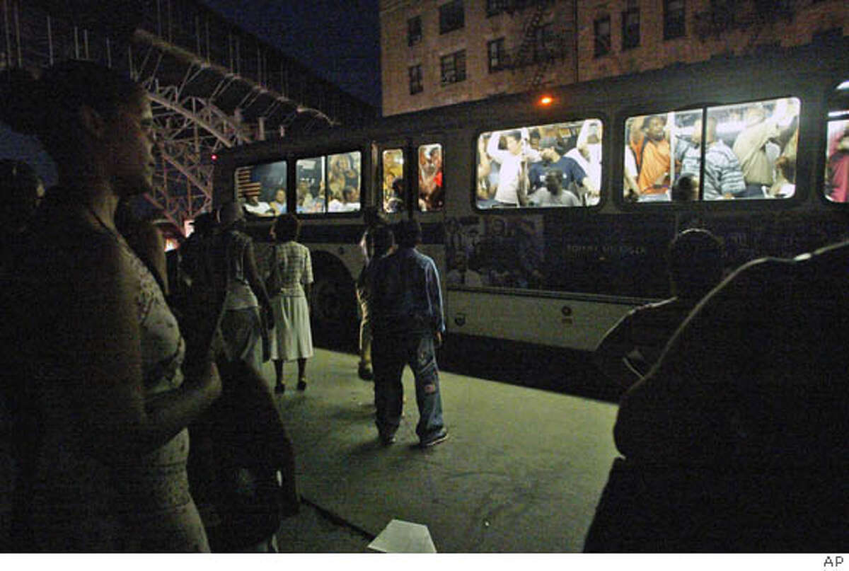 CYBER TERROR: Cyber terror was suspected in the 2003 Northeast blackout. But the cause turned out to be incompetence and falling trees. The power outage did not degrade U.S. military capabilities or damage the economy. At left, New Yorkers watch in the dark as a packed bus passes them by. Associated Press file photo, 2003, by Diane Bondareef