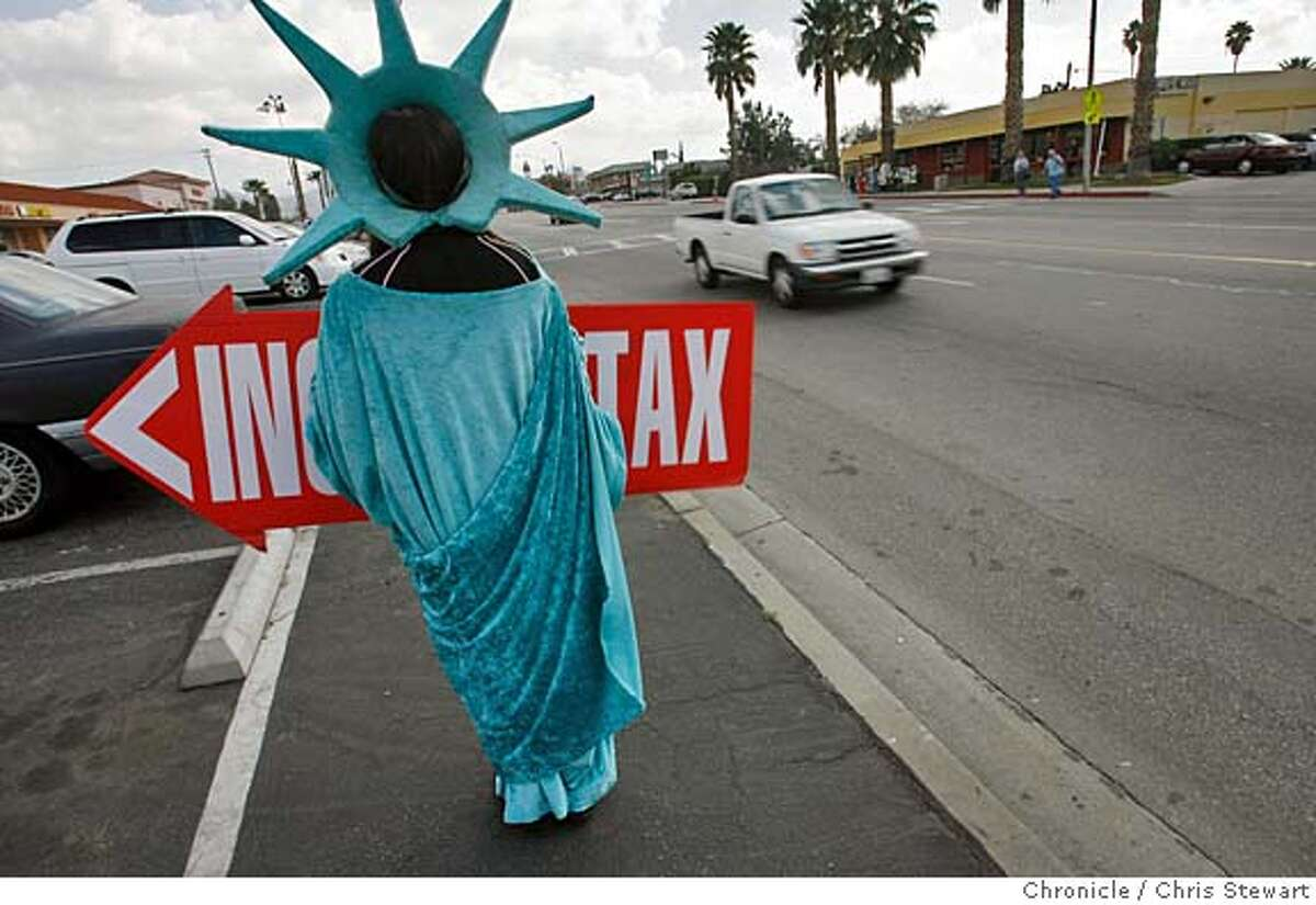 highland_162_cs.JPG Event on 2/17/06 in Highland. Lady Liberty patriotically advertises the Liberty Tax Service company in Highland, California. The city council of Highland, in San Bernardino County, unanimously passed a resolution which states, in part,