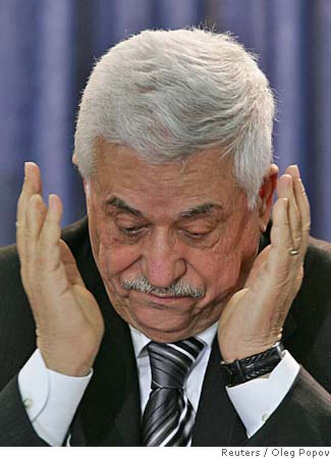 Palestinian President Mahmoud Abbas reacts during the swearing-in of the new Palestinian parliament at the Palestinian Authority headquarters in the West Bank city of Ramallah February 18, 2006. Hamas took over as the dominant party in the Palestinian parliament on Saturday and President Mahmoud Abbas challenged the militant Islamist group to recognise peace deals with Israel and maintain a truce. REUTERS/Oleg Popov 0 Photo: OLEG POPOV