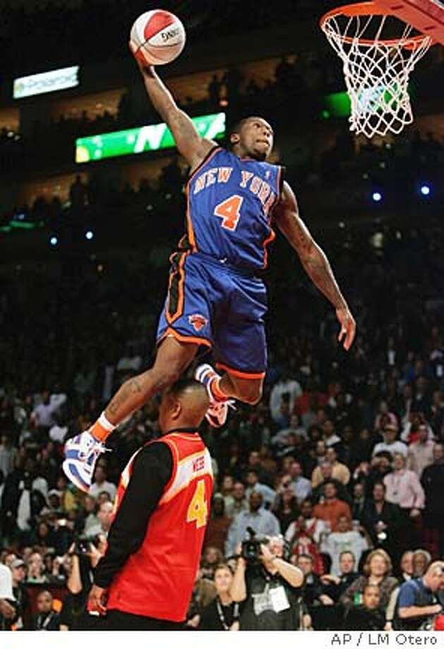 New York Knicks guard Nate Robinson flies over former Atlanta Braves guard Spud Webb during the slam dunk contest at NBA All-Star Saturday Night in Houston, Saturday, Feb. 18, 2006. (AP Photo/LM Otero) Photo: LM OTERO
