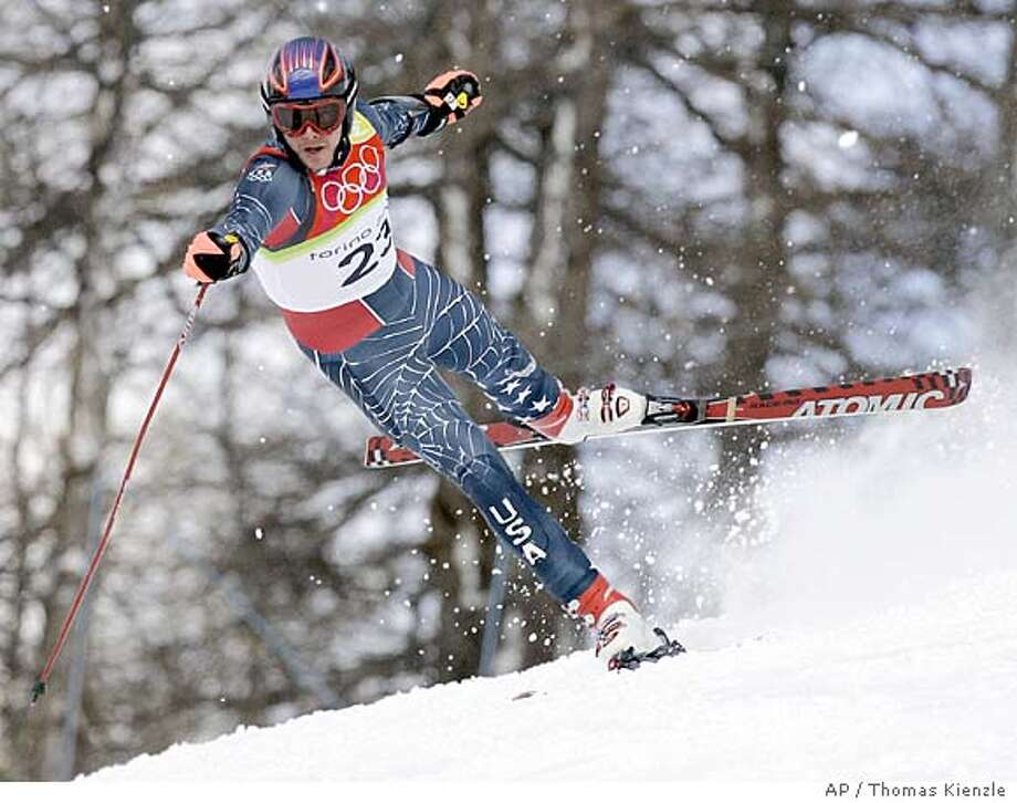 Bode Miller of the United States loses control and skis out of the course during the Men's Super-G at the Turin 2006 Winter Olympic Games in Sestriere Borgata, Italy Saturday Feb. 18, 2006. (AP Photo/Thomas Kienzle) Photo: THOMAS KIENZLE