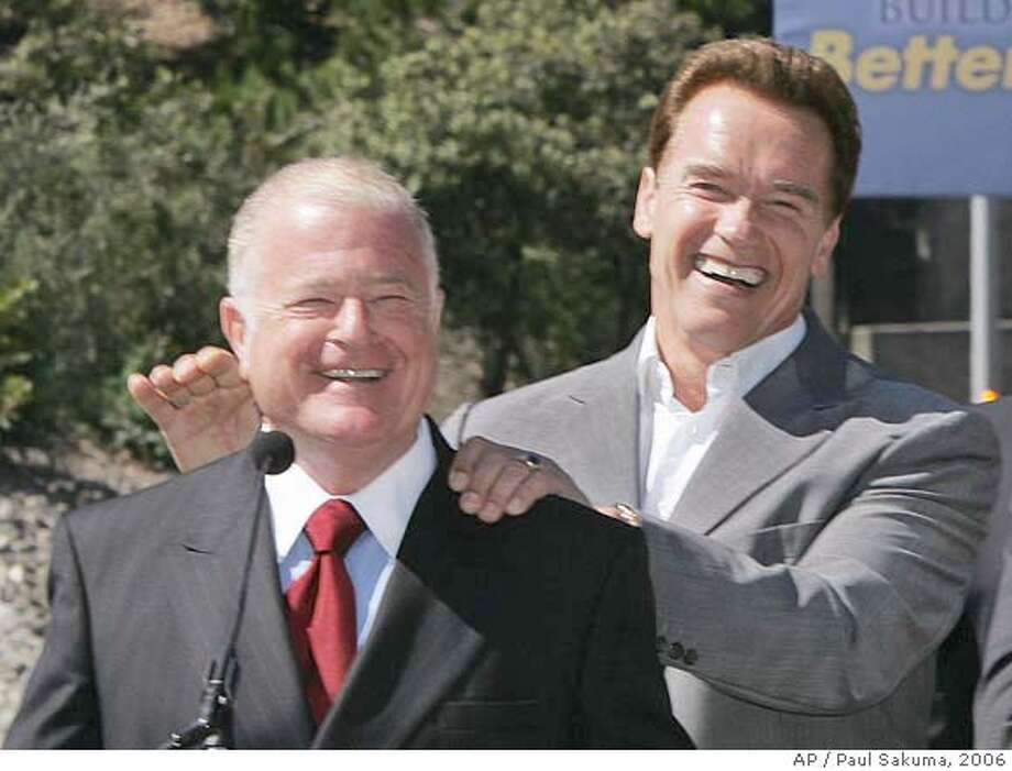 Gov. Arnold Schwarzenegger, center left, laughs with state Sen. Don Perata, D-Oakland, left, before he signed the largest of four public works bonds headed for the November ballot in Orinda, Calif., Tuesday, May 16, 2006. The transportation bond would provide $19.9 billion for highway, rail and port projects. Perata sponsored the bill. He is surrounded by other state elected officials in front of Caldecott Tunnel on Highway 24. (AP Photo/Paul Sakuma)  Ran on: 05-17-2006  Gov. Arnold Schwarzenegger (at lectern) is flanked by officials outside the Caldecott Tunnel.  Ran on: 05-17-2006  Gov. Arnold Schwarzenegger (at lectern) is flanked by officials outside the Caldecott Tunnel.  Ran on: 05-17-2006 Ran on: 05-17-2006 Photo: PAUL SAKUMA