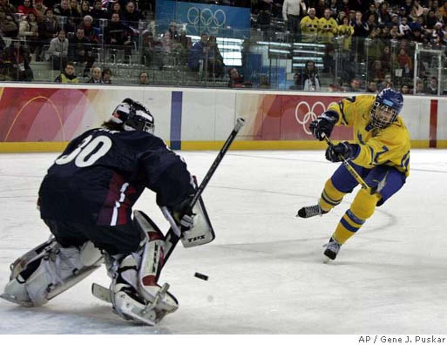 Sweden's Maria Rooth (7) scores the game-winning goal in a shoot out past the United States goalie Chanda Gunn during a 2006 Winter Olympics women's ice hockey semifinal game Friday, Feb. 17, 2006, in Turin, Italy. (AP Photo/Julie Jacoson)(AP Photo/Gene J. Puskar) Photo: GENE J. PUSKAR