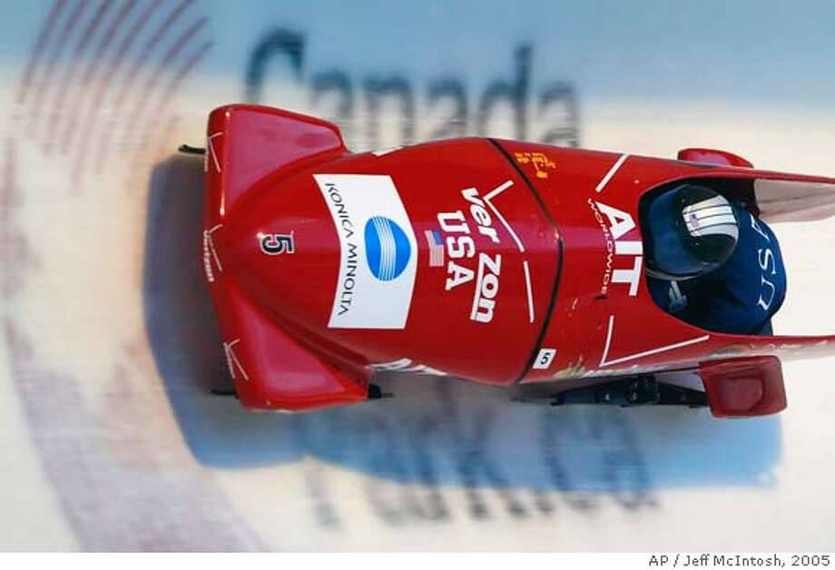 ** FOR USE AS DESIRED WITH 2006 TURIN WINTER OLYMPIC STORIES ** FILE ** United States' Shauna Rohbock, left, and Valerie Fleming, compete during World Championship women's bobsled in Calgary, Alberta, Canada, in this Feb. 25, 2005 photo. (AP Photo/Jeff McIntosh, CP) A FEB. 25, 2005 FILE PHOTO ** EFE OUT ** FOR USE AS DESIRED WITH 2006 TURIN WINTER OLYMPIC STORIES ** Photo: JEFF MCINTOSH