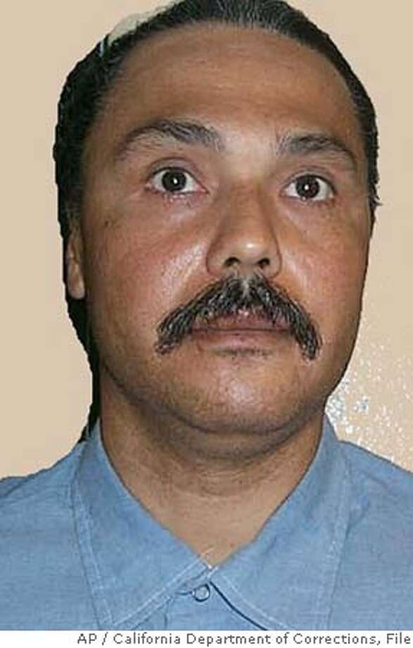 "** EDS: PHOTO HAS BEEN DIGITALLY ALTERED BY SOURCE TO REMOVE BACKGROUND ** In this photo released by the California Department of Corrections, Michael Morales, 46, of Stockton, Calif., is seen in an undated photo. Morales was convicted in 1983 of murdering 17-year-old Terri Winchell, who was found beaten and stabbed in a secluded vineyard. Lawyers for Morales who is scheduled to be lethally injected Tuesday, Feb. 21, 2006, are objecting to a court-ordered plan to alter the procedure, saying Thursday the revision reduces the condemned man ""to little more than a test subject."" (AP Photo/California Department of Corrections) PHOTO RELEASED BY THE CALIFORNIA DEPARTMENT OF CORRECTIONS. UNDATED PHOTO. EDS: PHOTO HAS BEEN DIGITALLY ALTERED BY SOURCE TO REMOVE BACKGROUND. Photo: Ap"