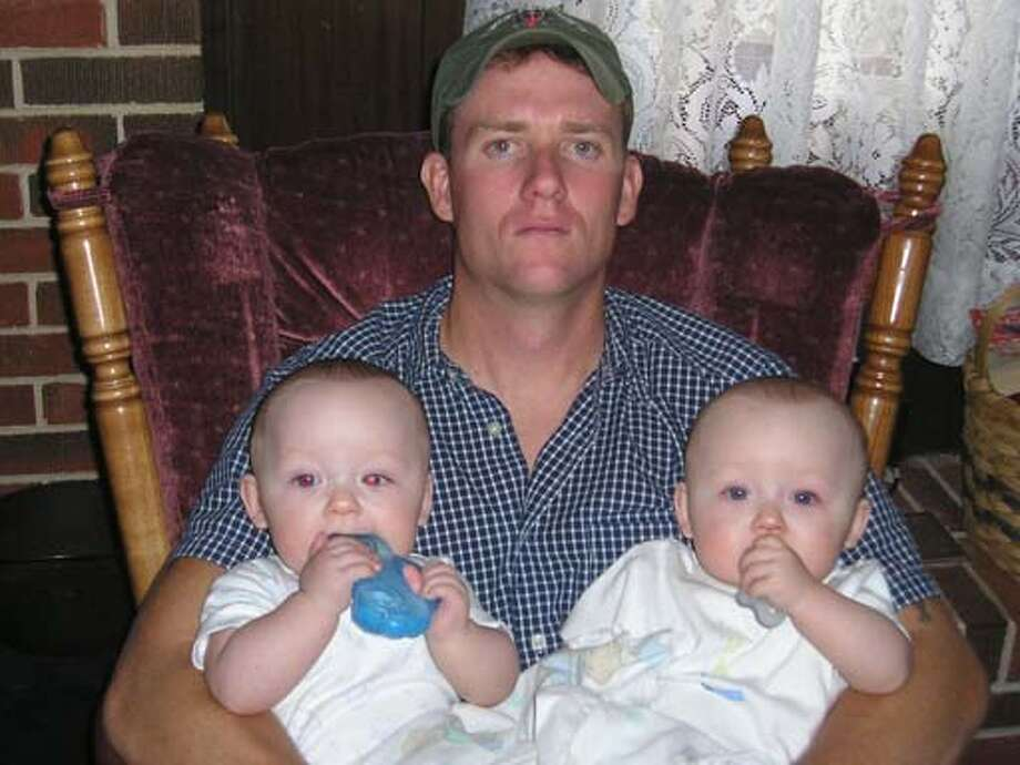 �Sgt. 1st Class Chad A. Gonsalves, 31, of Turlock, Calif. died north of Deh Rawod, Afghanistan, on Feb. 13, when an improvised explosive device detonated near his��HMMWV during combat operations.�Gonsalves was assigned to the 3rd Battalion, 7th Special Forces Group, Fort Bragg, N.C.��With him are his sons Cody, 3, and twins Blake and Dylan, 18 months.� Photo: HO