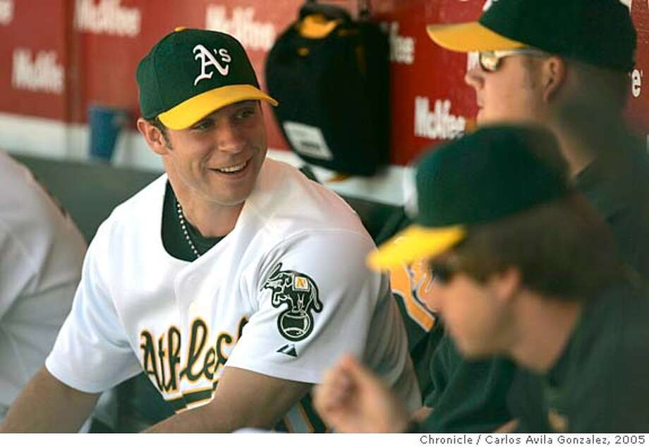 ATHLETICS_008_CAG.JPG  A very happy Rich Harden jokes around in the dugout after he held the Giants to 1 hit in 7 innings. The Oakland Athletics played the San Francisco Giants at McAfee Coliseum in Oakland, Ca., on Sunday, June 26, 2005. The Athletics won the game, 16-0, the third worst shutout in Giants history. Photo by Carlos Avila Gonzalez / The San Francisco Chronicle  Photo taken on 6/26/05, in Oakland,CA. Ran on: 06-27-2005  Rich Harden enjoys the good times in the Oakland dugout. Ran on: 06-27-2005  Rich Harden enjoys the good times in the Oakland dugout. Photo: Carlos Avila Gonzalez