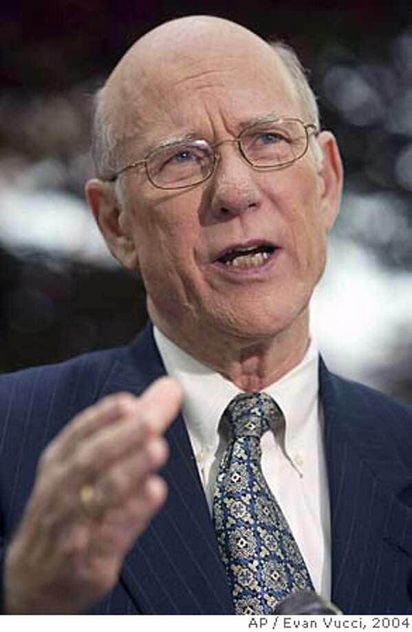 "Senate Intelligence Committee Chairman Pat Roberts, R- Kan., gestures as he talks with media on Sunday, Nov. 21, 2004 in Washington. Roberts said the chances that Congress will pass the intelligence bill in December ""are slim and none, and slim left town."" (AP Photo/Evan Vucci) Ran on: 11-22-2004  Sen. Pat Roberts, head of the Senate Intelligence Committee, doubts that the counterterror bill will be passed by year's end. Photo: EVAN VUCCI"