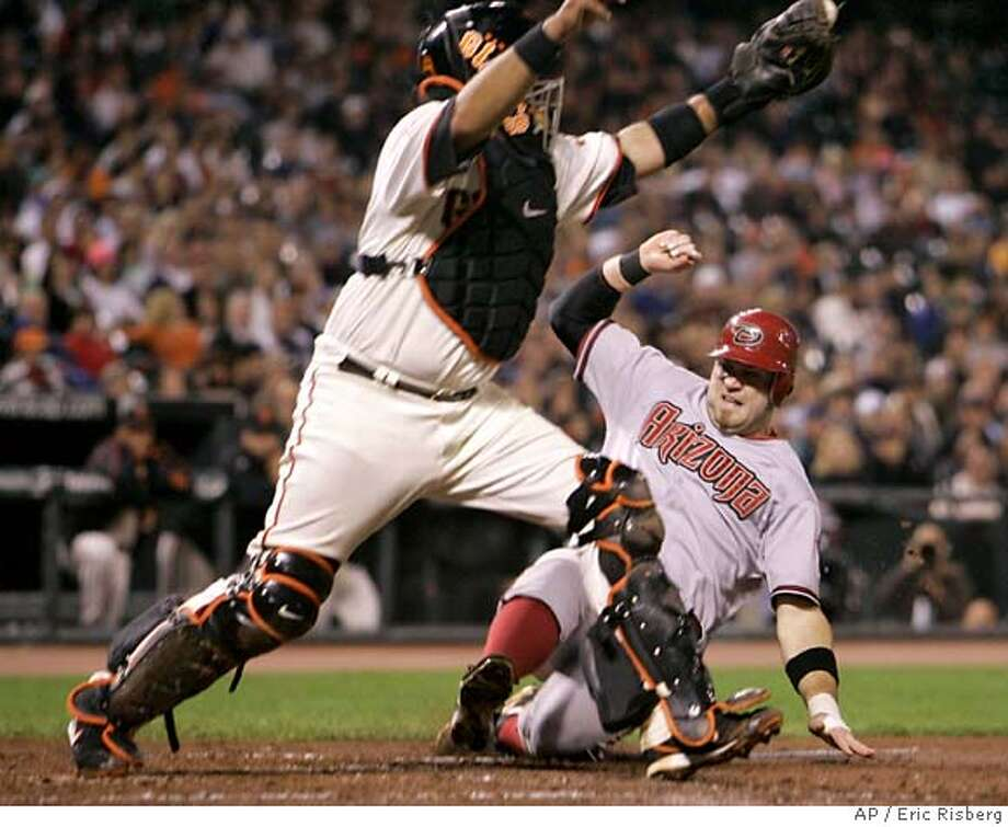 Arizona Diamondbacks' Chris Snyder, right, is forced out at home plate by San Francisco Giants catcher Bengie Molina, left, on a fielder's choice in the fourth inning of a baseball game in San Francisco, Wednesday, Sept. 12, 2007. (AP Photo/Eric Risberg) Photo: Eric Risberg