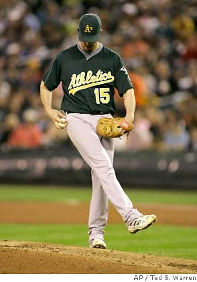 Oakland Athletics starting pitcher Dan Haren kicks at dirt on the mound after giving up a run to the Seattle Mariners in the fourth inning of an MLB baseball game Wednesday, Sept. 12, 2007 at Safeco Field in Seattle. Mariners' Yuniesky Betancourt hit a sacrifice fly on the play that scored Ben Broussard. (AP Photo/Ted S. Warren) Photo: Ted S. Warren