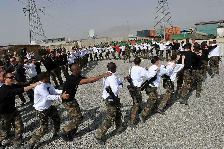 French soldiers with the NATO-led International Security Assistance Force (ISAF) dance during a sports competition at their base at the Surobi district in Kabul province on March 17, 2012.  Around 200 French soldiers are due to leave Afghanistan by the end of March 2012. Some 600 soldiers are actually based at the camp, located east of the capital Kabul.  AFP PHOTO/SHAH Marai (Photo credit should read SHAH MARAI/AFP/Getty Images) Photo: Shah Marai, AFP/Getty Images