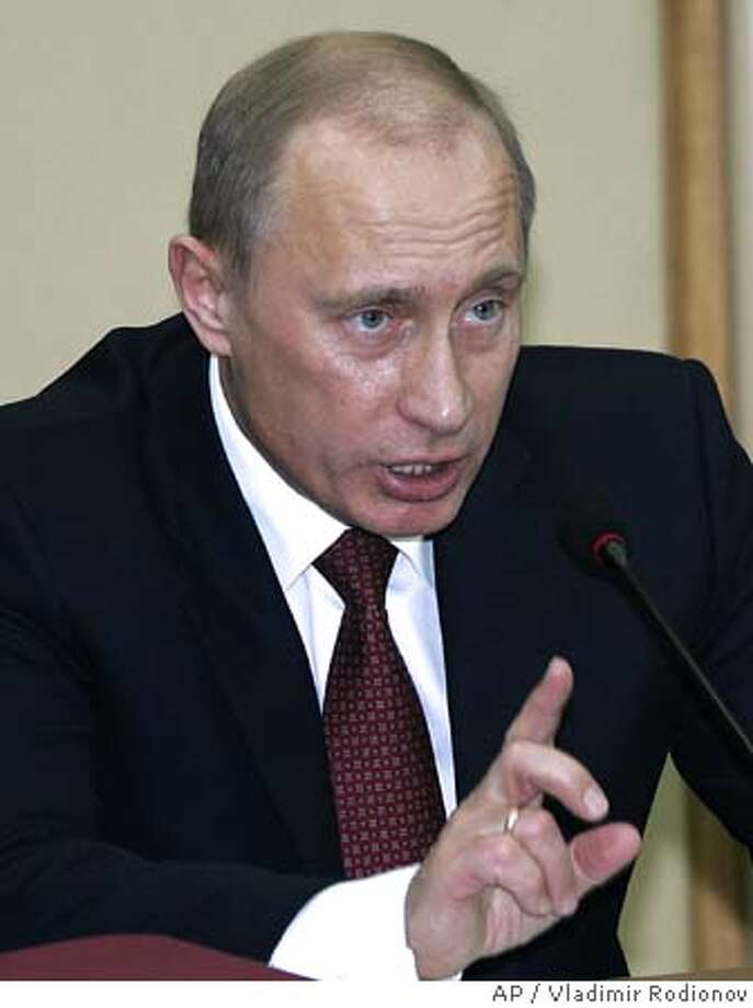 President Vladimir Putin gestures speaking at a State Council meeting in Nizhny Novgorod, about 400 km (250 miles) east of Moscow, Thursday, Feb. 16, 2006. (AP Photo/ , Vladimir Rodionov, Presidential Press Service) Photo: VLADIMIR RODIONOV
