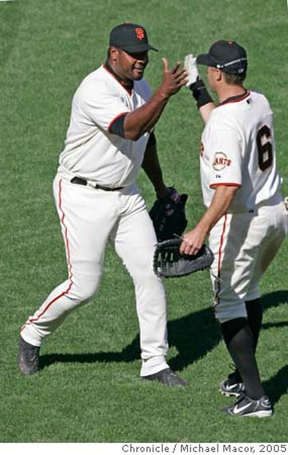 giants_291_mac.jpg Armando Benitez	, left and J.T. Snow celebrate as Benitez, closes out the 9th inning to get the save in the 4-2 victory over the Dodgers.Opening day of the 2005 baseball season for the San Francisco Giants. The Giants take on the Los Angeles Dodgers. 4/5/05 San Francisco, Ca Michael Macor / San Francisco Chronicle Mandatory Credit for Photographer and San Francisco Chronicle/ - Magazine Out Photo: Michael Macor
