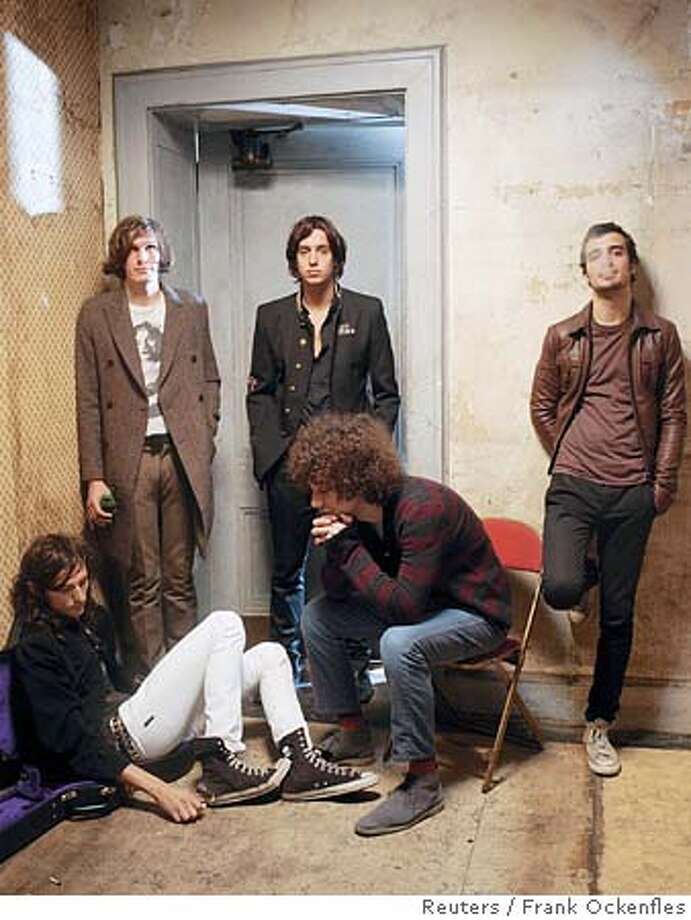 "Members of the band The Strokes are seen in this undated handout photo. Once hailed as a savior of rock for a sound one critic called a ""new wave, garage rock revival,"" The Strokes have yet to achieve the stardom that might have been expected of them after their debut album in 2001. NO ARCHIVE To accompany feature Leisure-Strokes REUTERS/Frank Ockenfles/The Strokes/Handout 0 Photo: HO"
