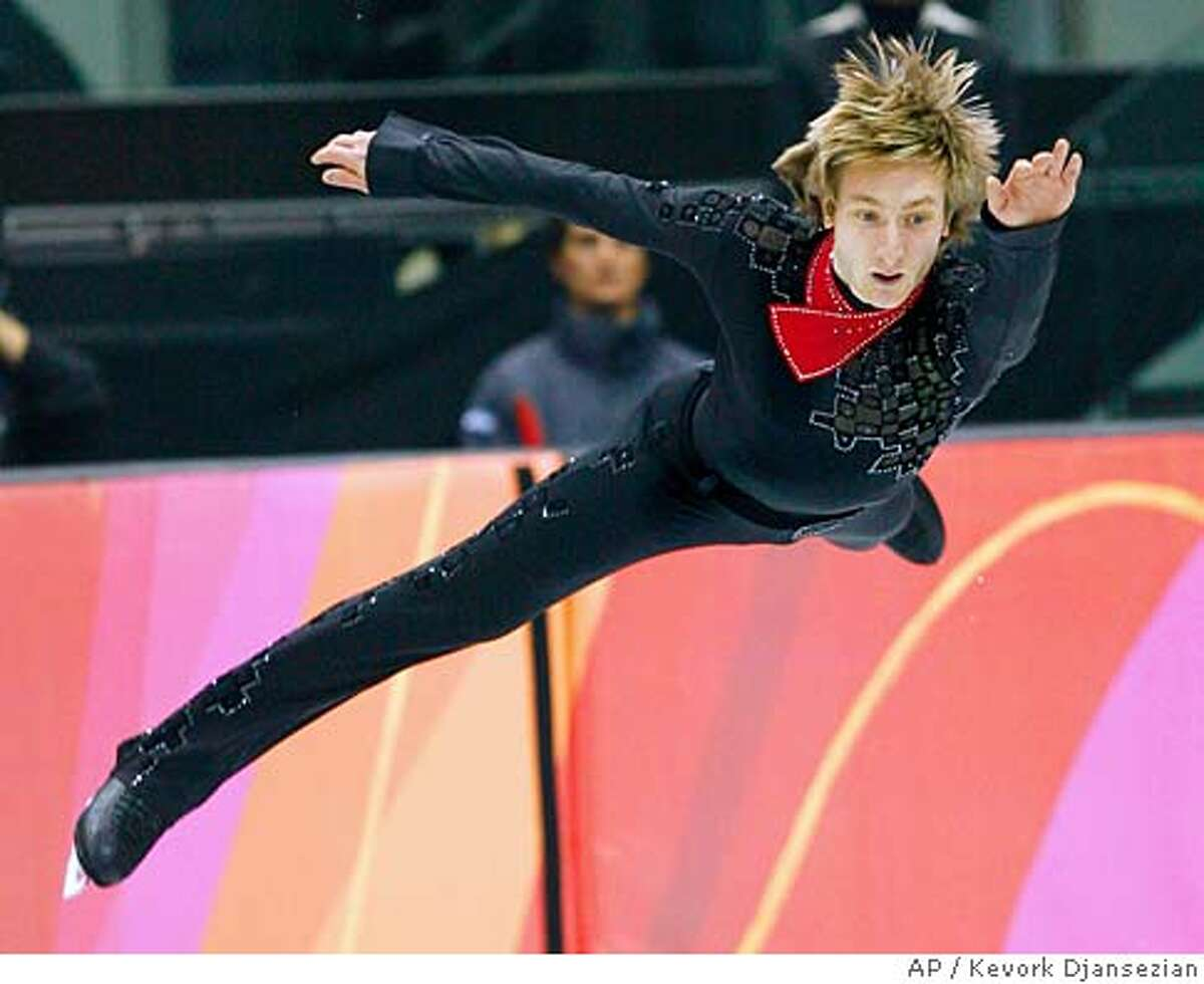 Evgeni Plushenko, of Russia, performs during his routine in the Men's Free Skate in figure skating at the Turin 2006 Winter Olympic Games in Turin, Italy on Thursday, Feb. 16, 2006. (AP Photo/Kevork Djansezian)