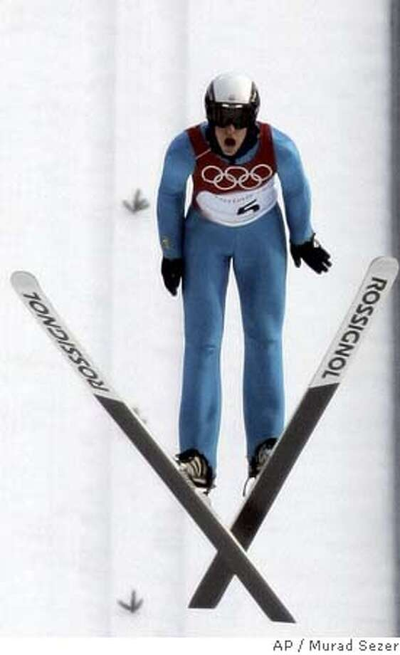 Anders Johnson of the United States jumps off the Large Hill, shortly before official ski jumping training was cancelled because of high winds at the Turin 2006 Winter Olympic Games in Pragelato, Italy,Thursday Feb. 16, 2006.(AP Photo/Murad Sezer) Photo: MURAD SEZER