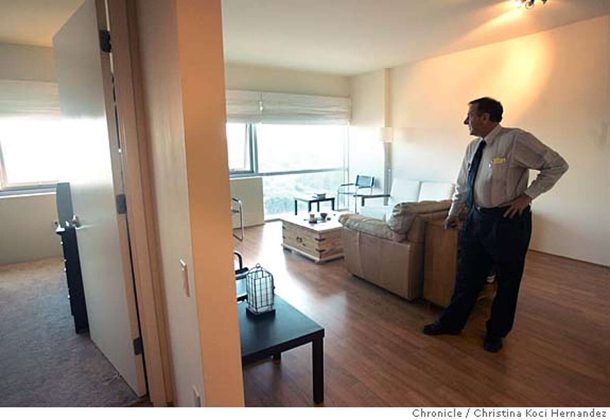 CHRISTINA KOCI HERNANDEZ/CHRONICLE Prudential real estate agent, Lee Ginsburg, in a condo for sale in South San Francisco. In 45 min. 2 people showed, both already owning units in the building.