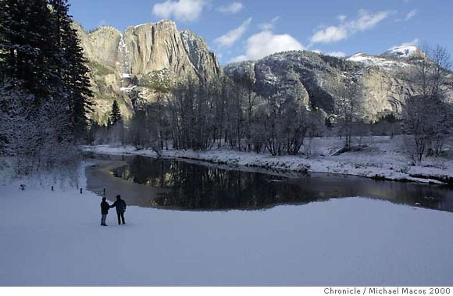 YOSEMITE6-C-14NOV00-MN-MAC the Yosemite Valley had 3 inches of new snow fall overnight. A stop along the Meced River at swinging Bridge, with Yosemite Falls in the background. Interior Secretary Bruce Babbit announces the final plan to restore Yosemite Valley. by Michael Macor/The Chronicle Photo: MICHAEL MACOR