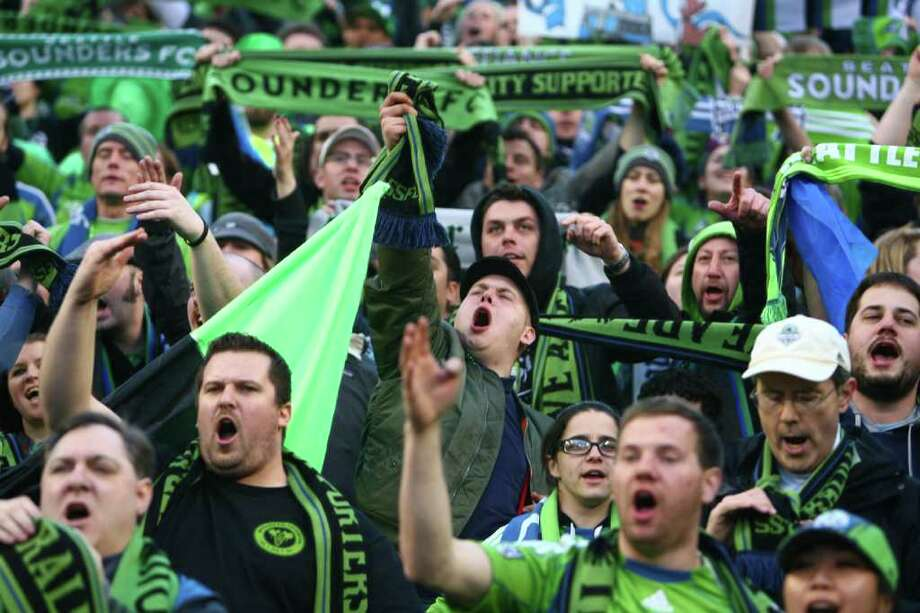 Fans cheer during the Seattle Sounders MLS season opener against Toronto FC on Saturday, March 17, 2012 at CenturyLink Field in Seattle. Photo: JOSHUA TRUJILLO / SEATTLEPI.COM