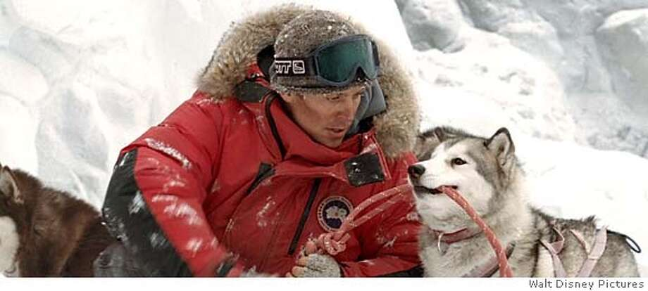 "Gerry Shepherd (Paul Walker) is forced to leave his team of sled dogs behind, as the team fend for their survival, in ""Eight Below."" (AP Photo/Walt Disney Pictures) Photo: -"